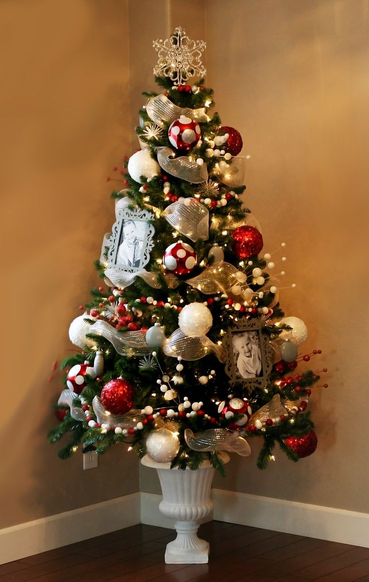 idea for christmas decorating small fake trees in urns