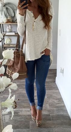 I like the shape and color of this shirt with the necklace and purse.  I wear skinny jeans but much &q