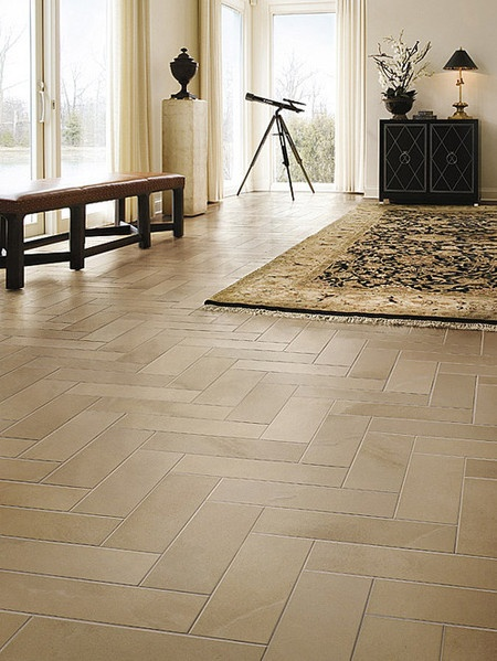 Long plank tiles set in a herringbone pattern For the