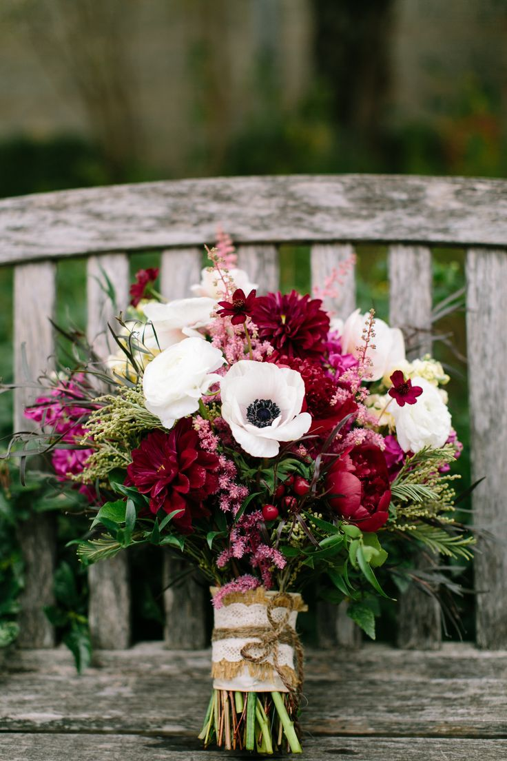 i loved my bouquet!! wine colored peonies, anemones for pops of white, and greenery. it was a wildflower textured bouquet for fall