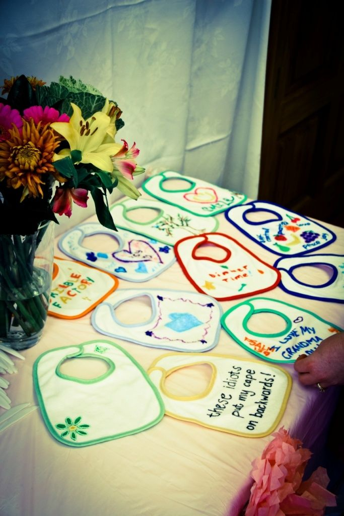 baby shower game: Get fabric pens and each guest personalizes a bib for the baby ( would be better if