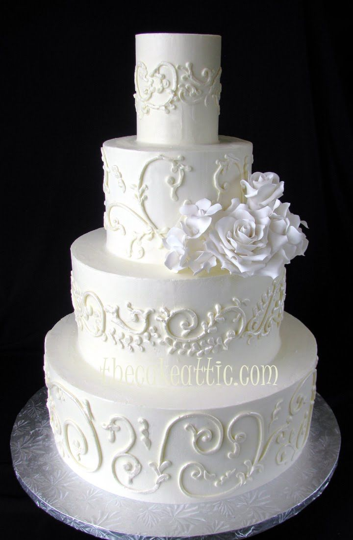 White On White Buttercream Wedding Cake With Scroll Work