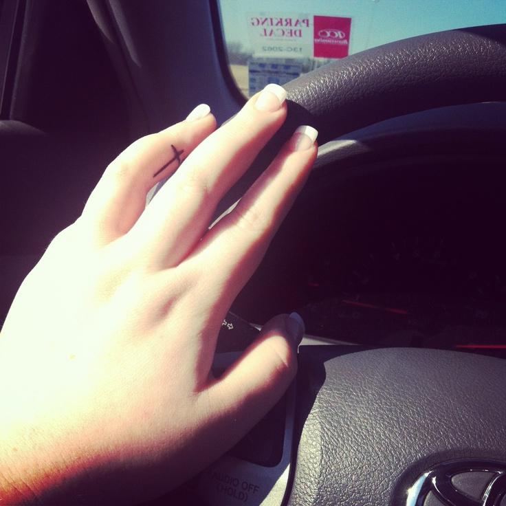 Cross finger tattoo.