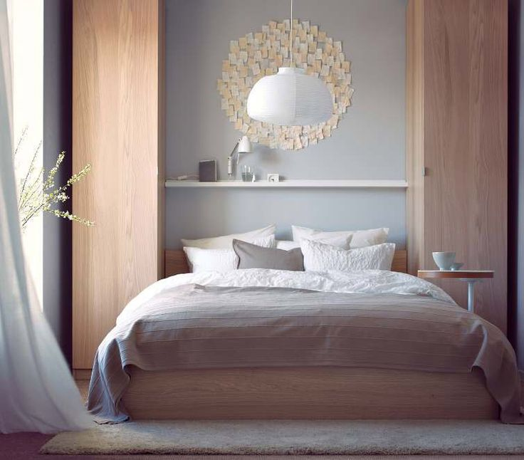 Narrow Wardrobes On Either Side Of Bed With Shelf Across