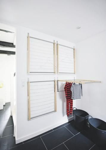 Four wall-mounted drying racks in a mudroom create an instant indoor drying room