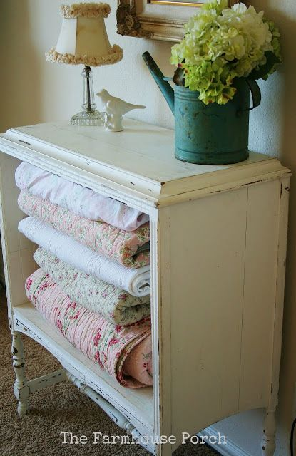 Take the drawers out of an old nightstand or small dresser and use to store quilts practically but visibly. ♥