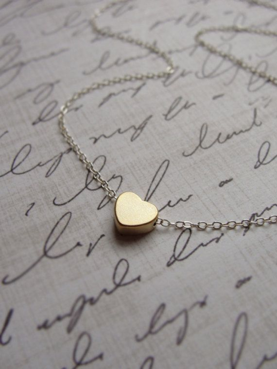 Tiny gold heart necklace  silver and gold by OliveYewJewels, $25.00… someone tell my husband. Ha