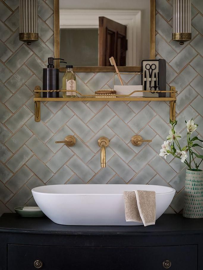 Gold fixtures, white vessel sink and black vanity. Classy and clean design. Visit bountybrassware.us for clean and elegantly designed bathroom products.: