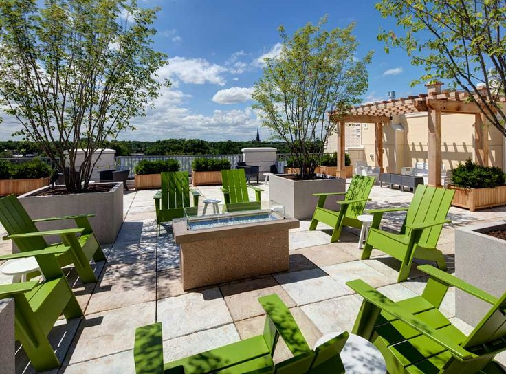 Rooftop terrace with fire pit, trellis areas, lounge