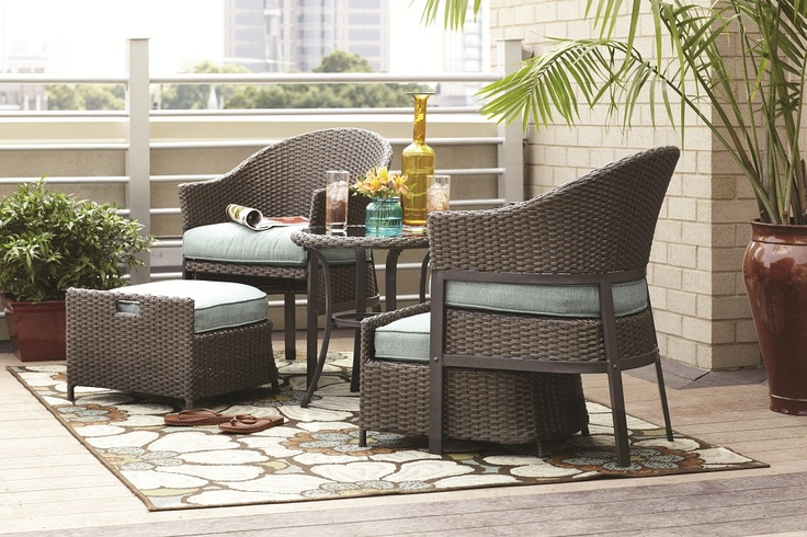 A 5Piece patio conversation set, made of wicker with