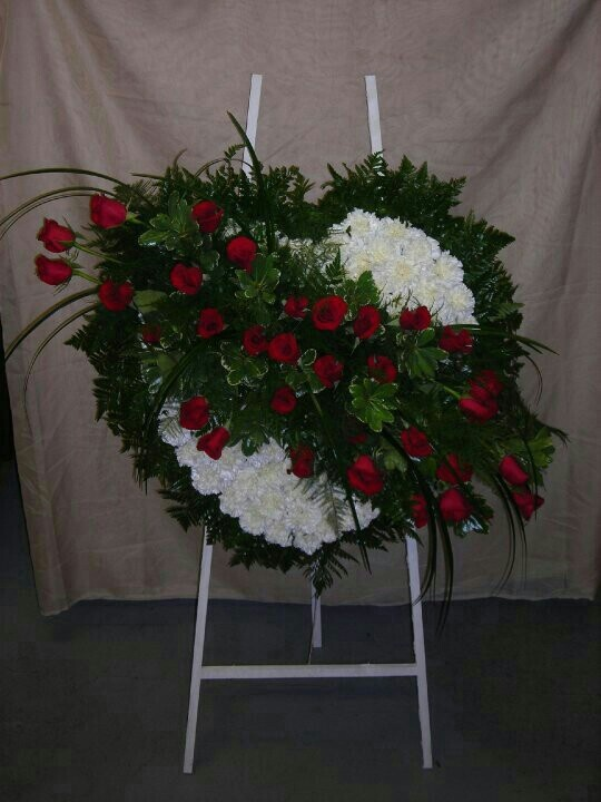 Bleeding heart spray, white carnations base with a red