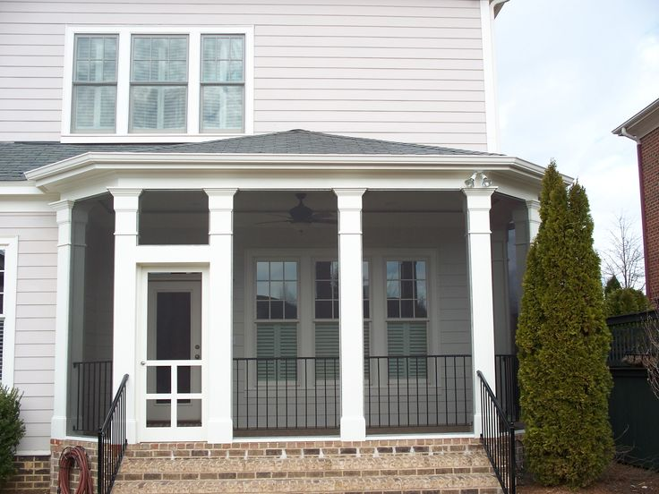 Hip Style Roof Screened In Porch With Decorative Columns