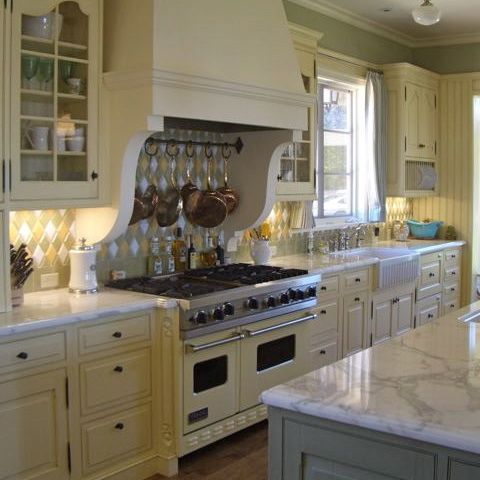 Happy Yellow Kitchen Cabinets With Marble Counters And