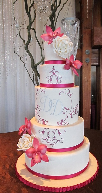 fuschia & white wedding cake with sugar orchids and roses