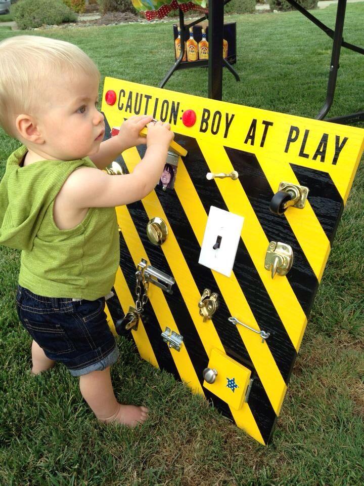 Boy at play board 1 year old birthday gift genius idea