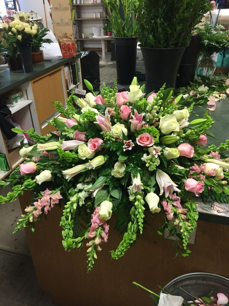 Pink and white Casket arrangement by Vicky Funeral
