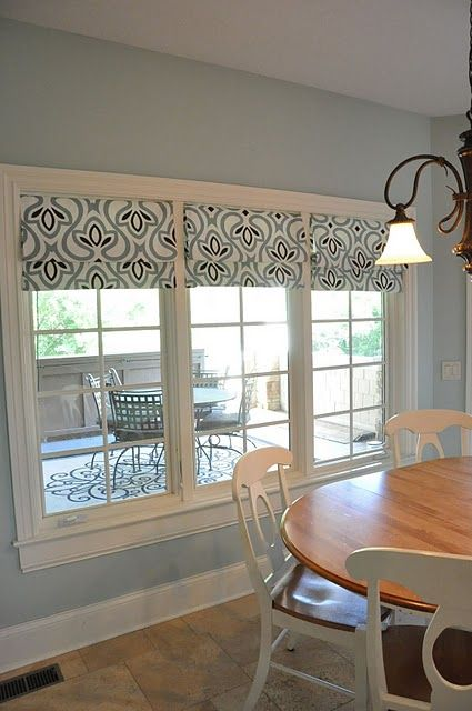 No Sew Roman Shades made from a Target Tablecloth and tension rods.  This is
