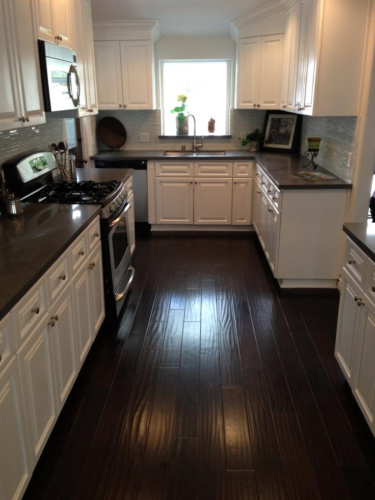 Kitchen Dark counters, dark floors, white