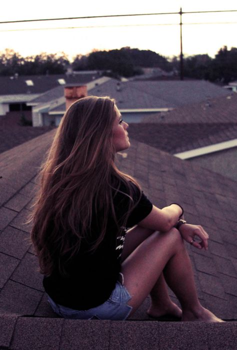 Sitting on the roof and thinking on a summer night. Watching the sun go down is