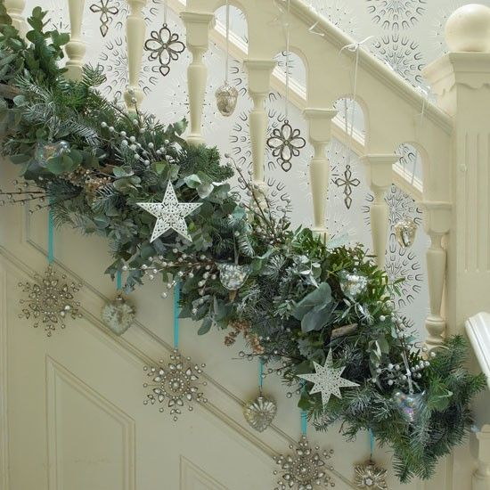 What a different way to hang garland on the stairs!  I prefer a more traditional greenery, but I think it's interesting how it is