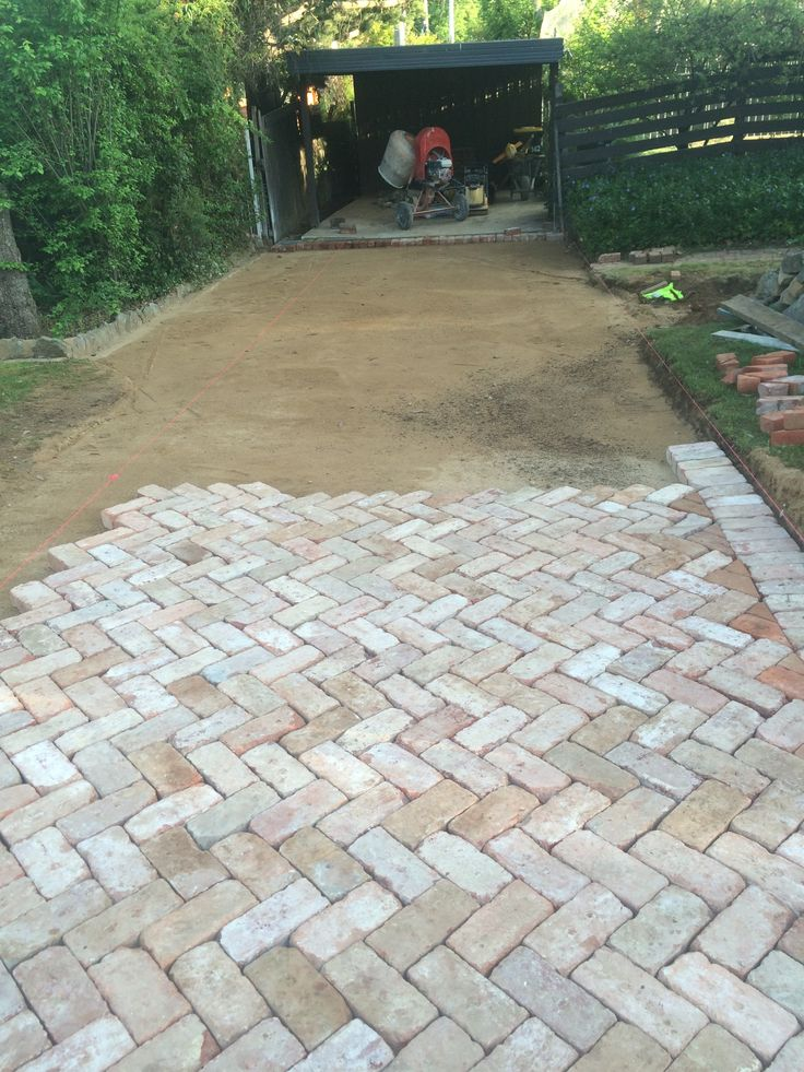 Bedding sand and paving in progress. Canberra Red Brick