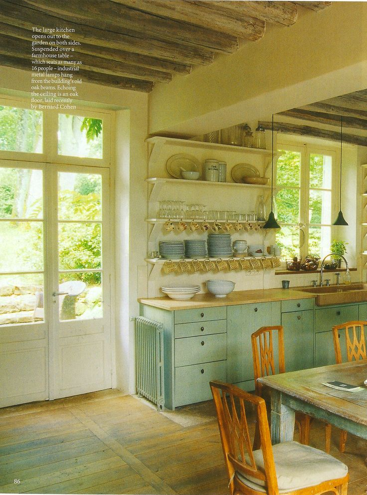 A kitchen with no upper plenty of light, and a
