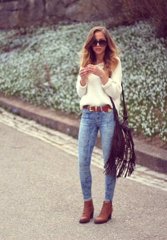 Lace Pattern Light Blue Jeans, Tan Ankle Boots, Leather Belt, White Sweater, Curled Hair, Red Lipstick, Sunglasses, Native American Inspired Bag.