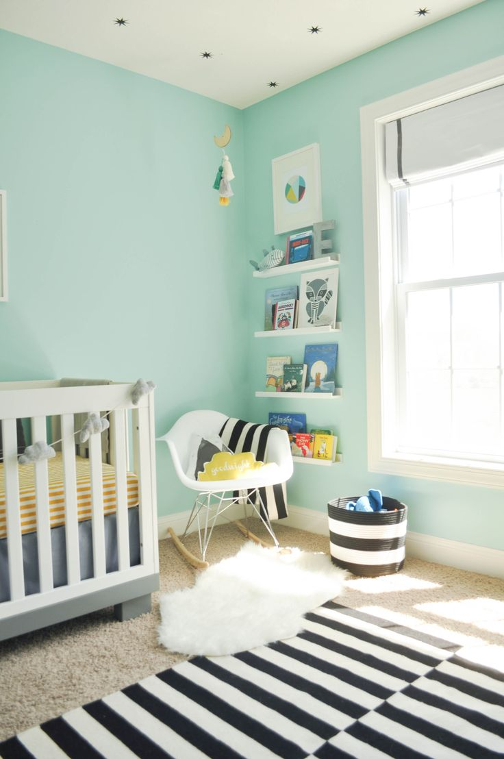Modern And Whimsical Nursery With Turquoise Blue Walls And