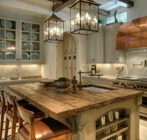 what a gorgeous and spacious kitchen! every womens dream! lol LOVE the big heavy