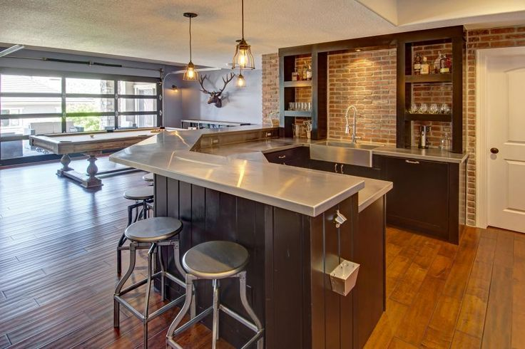 This Spacious Basement Wet Bar Features Stainless Steel