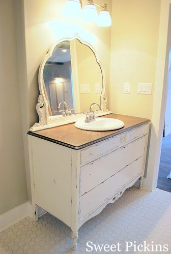 Dresser made into bathroom vanity; I would put the sink either to the right or l