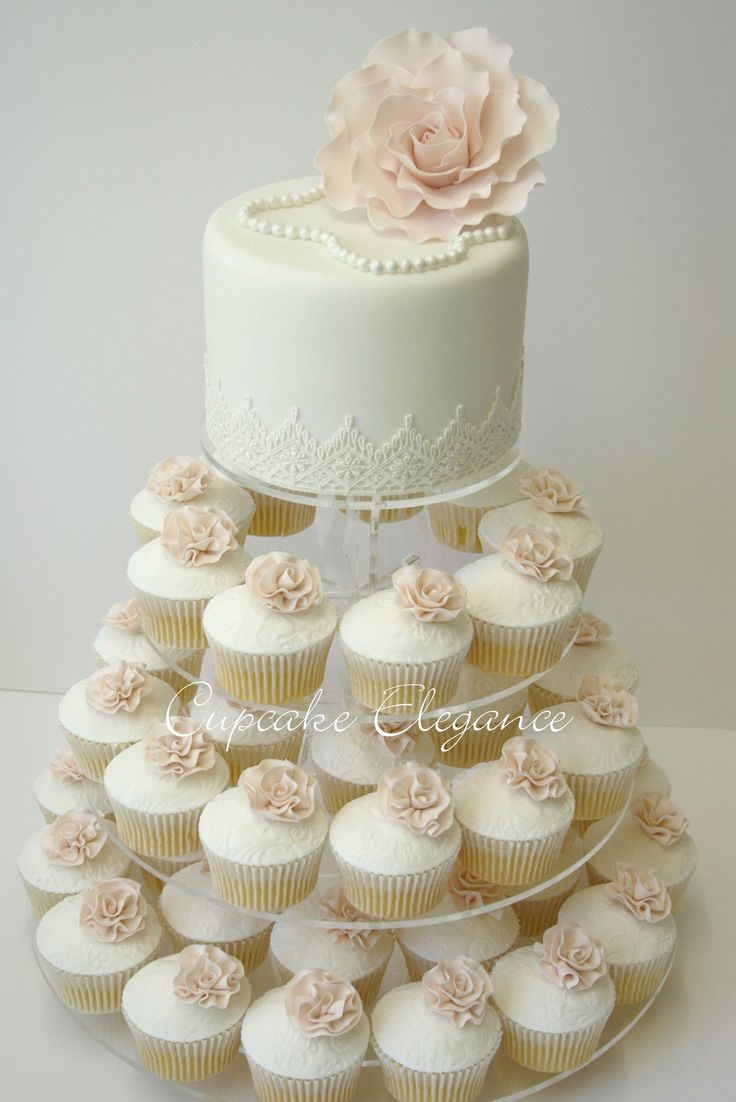 Cupcakes are fun!  But, this is great idea because you still have a wedding cake for your 1 year anniversary.