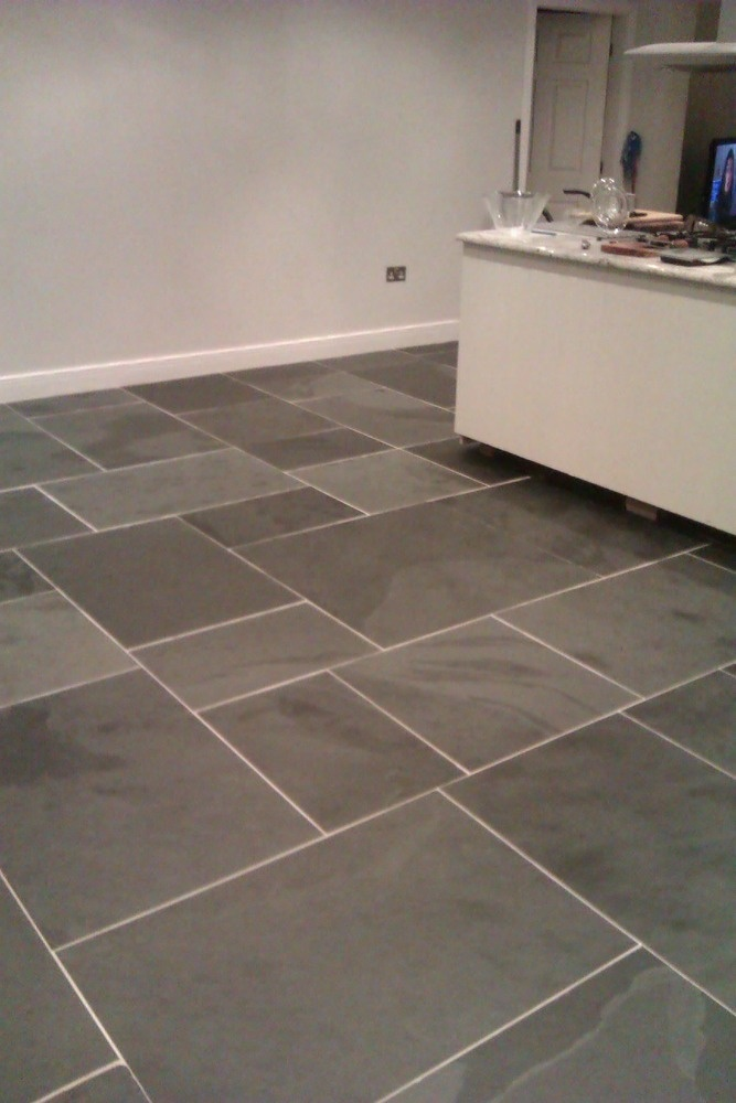 Large rectangular 'clean' slate tiles laid on kitchen