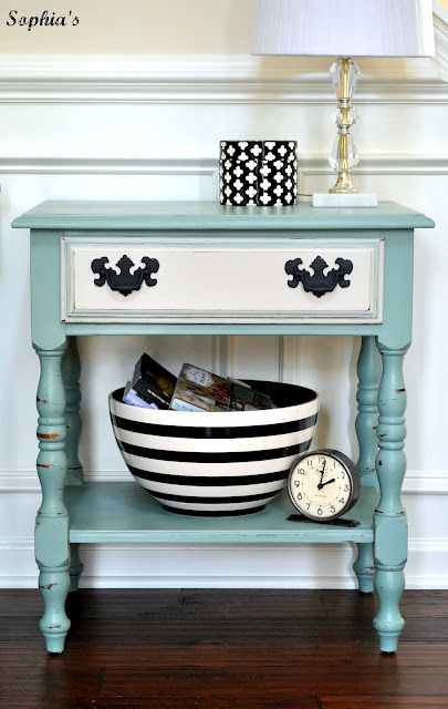 I have two small tables in my family room that I going to paint like this.  SO