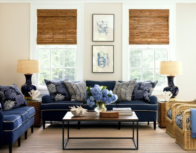 Living Room With Two Navy Sofas With White Piping And Blue