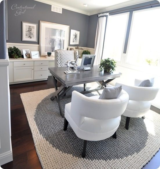 I would rearrange this as a home office and use the two white chairs as a seating area by the window and put a table between them.