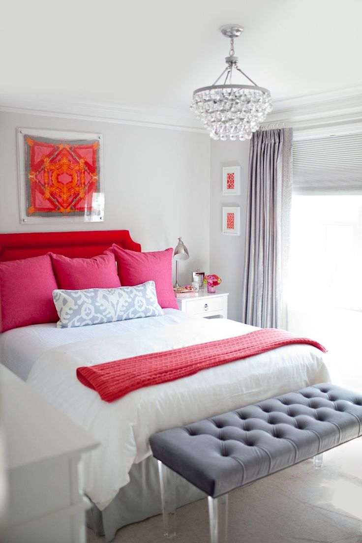 Decorating with Red: Adding pops of pink and coral to this decorating scheme offsets the bold red headboard and adds more interest.