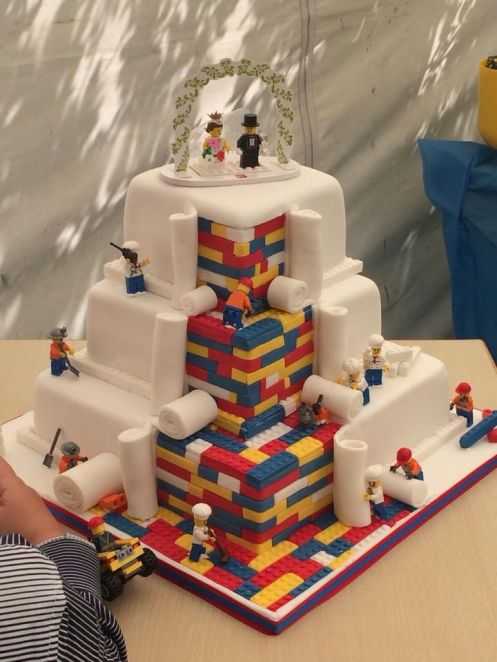 LEGO Wedding Cake Built Out of Tiny Fondant LEGO Bricks With Worker Minifigs Rolling Out a Final Layer of Icing: