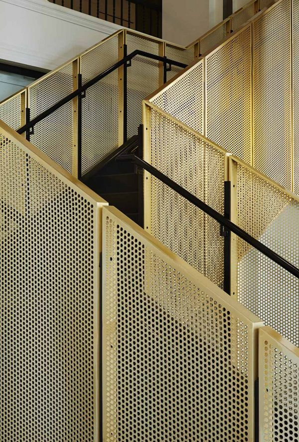 A stunning staircase in perforated metal by Studio Gang