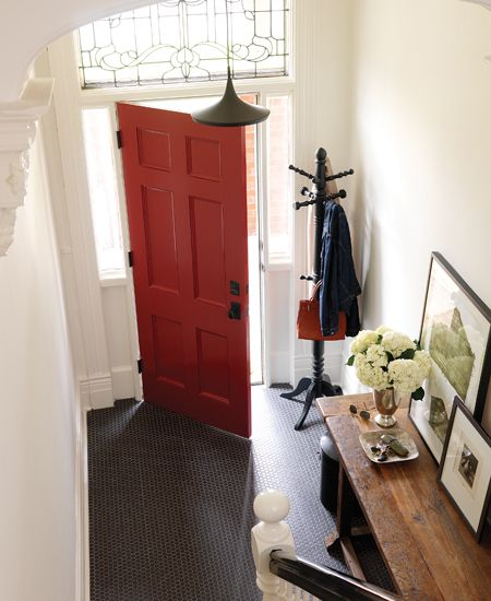 Decorating with Red: Classic red front door with black penny tile