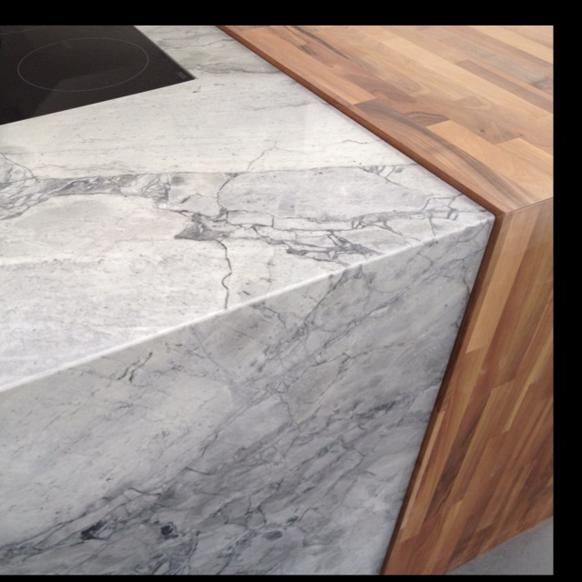 Mitred Bianco Eclipsia Marble Worktop And End Panel Combined With Solid Walnut Bar Top