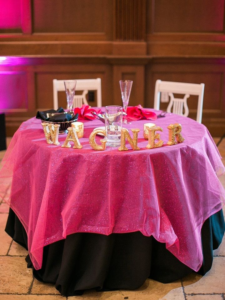 Black Table Linen With A Specialty Pink Overlay Pink