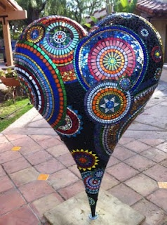 Incredible mosaic heart, nearly 5′ tall, by Sue Ferrante. The work in progress p