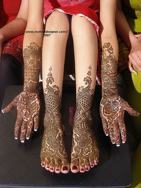 In India, brides traditionally wear henna on their wedding day...with the groom's name hidden somewhere in the design for the groom to find. Also, the bride is not supposed to do housework until the henna has faded--now that, I could do!: