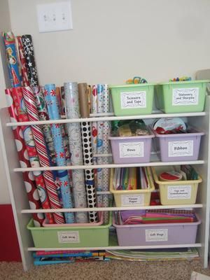 DIY gift wrap station repurposed from an old toy organizer, plus more gift wrap organization ideas {featured on Home Storage
