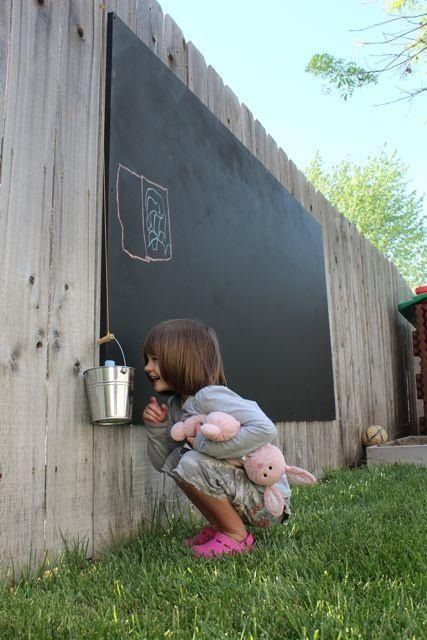 I like the idea of an outdoor chalkboard so kids can color without being out front of the driveway or blocking the patio when