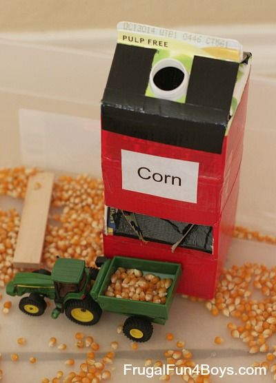 """""""Grain silo"""" for farm sensory bin/ tractor loading. Made with milk container, cereal box and duct tape"""