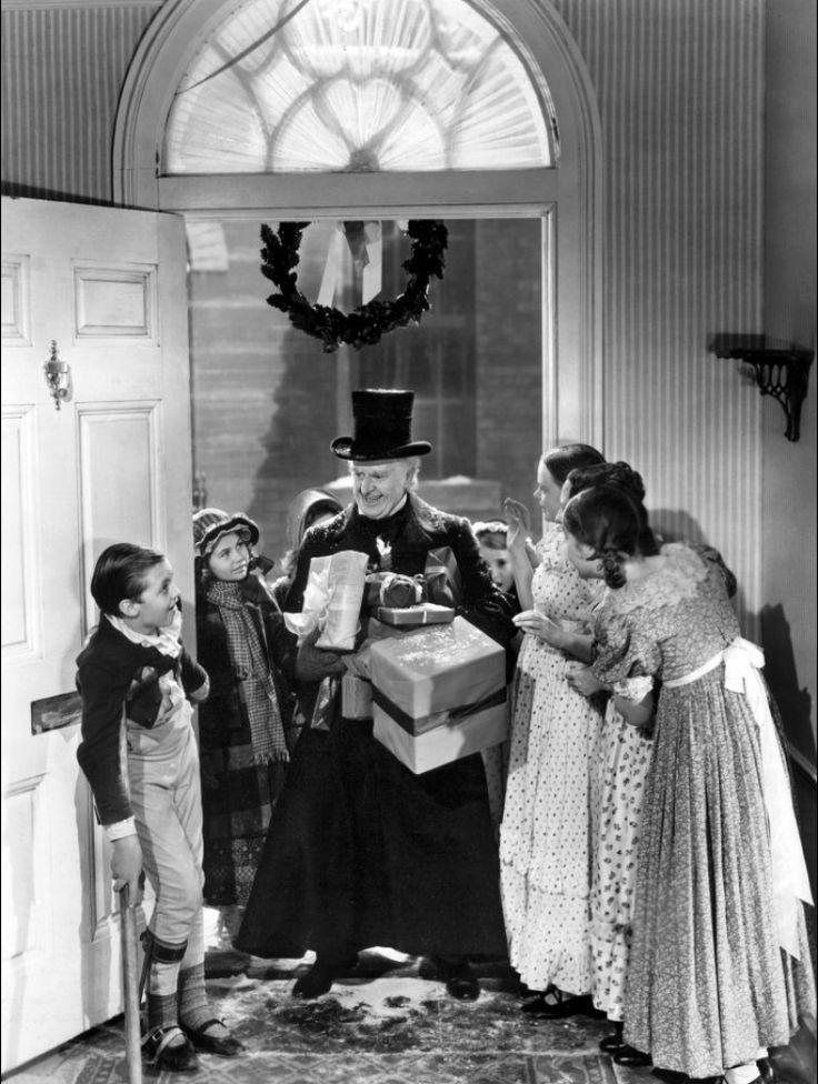 Reginald Owen as Ebenezer Scrooge and Terry Kilburn as