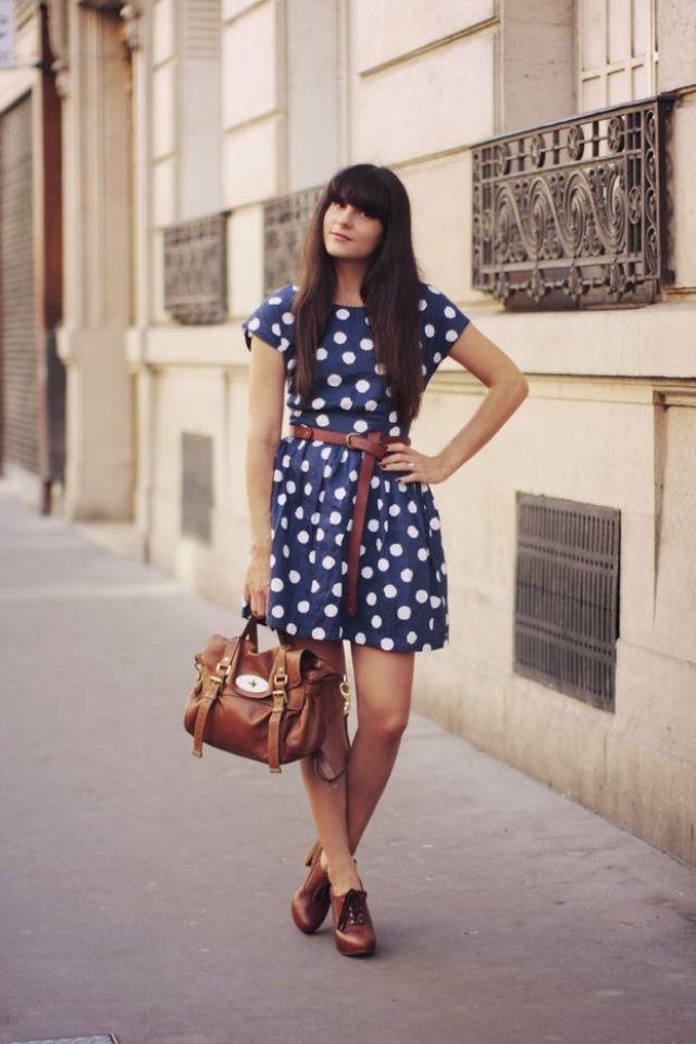 Polka dot dress with tan accessories.