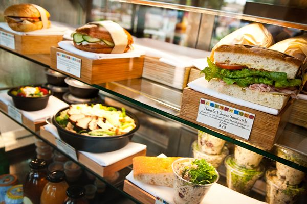 Display Case Of Sandwiches, Salads, And Beverages At The
